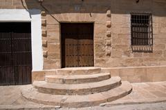 Access door of wood in Sabiote, Jaen province, Andalusia, Spain Stock Photos