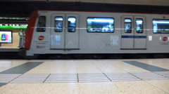 Spain Catalonia Barcelona inside Metro platform train arriving Passeig de Gracia Stock Footage