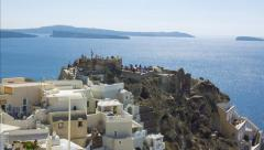 Santorini tilt-up from the bottom of steps to the top of buildings sparkling sea Stock Footage