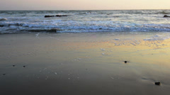Calm evening surf at atlantic ocean coastline Stock Footage