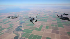 KC-130J Refuels F-35B Lightning II joint strike fighters and Harriers in mid-air - stock footage