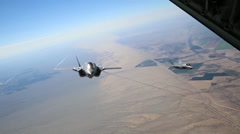 KC-130J Refuels F-35B Lightning II joint strike fighters in mid-air - stock footage