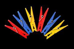 Motley clothespins Stock Photos