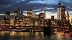 New York City Brooklyn Bridge downtown skyline evening - stock footage