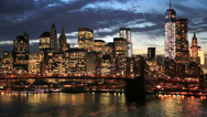 Stock Video Footage of New York City Brooklyn Bridge downtown skyline evening