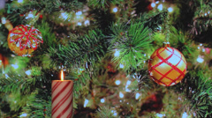 Red candy cane candle with holiday decorations Stock Footage