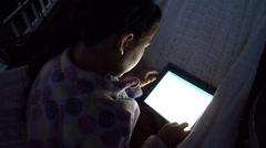 Stock Video Footage of Young Girl on iPad at Night