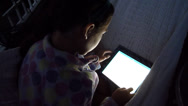 Young Girl on iPad at Night Stock Footage