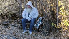 Man homeless in woods wave viewer away HD 0150 Stock Footage