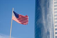 us flag and skyscraper - stock photo