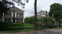 MIDDENBEEMSTER, THE NETHERLANDS -  Manor house + pan street in village Stock Footage