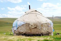 Dwelling of the nomad in mountains of kazakhstan Stock Photos