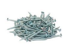 random pile of round threaded steel screw - stock photo