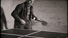 675 - men play ping pong in the basement play area - vintage film home movie Stock Footage