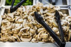 Champignons in a pan, sliced Stock Photos