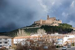 la mota castle on the hill, alcala la real, jaen province, andalusia, spain - stock photo