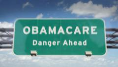 Obamacare Danger Ahead Road Sign Stock Footage