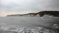 Insland Ruegen - Boat in front of chalk cliffs 02 Stock Footage