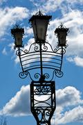 Lamppost silhouette against the sky Stock Photos