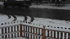 DOWNWARD JIB SNOWING FRONTYARD Stock Footage