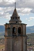 Bell tower of abbey church of la mota castle, Alcala la real, Jaen Stock Photos