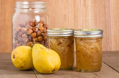 Hazelnut and pear conserve in jars Stock Photos