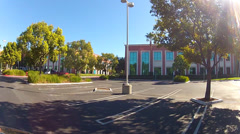POV Rolling By New Office Bldg Complex In Orange California Stock Footage