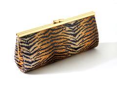 sequins tiger golden clutch - stock photo