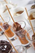 asian fusion lamb on stick in shot glass with sauce - stock photo