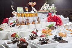 asian fusion appetizers and desserts on table - stock photo