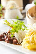 asian dish with beef, noodles and vegetables. - stock photo