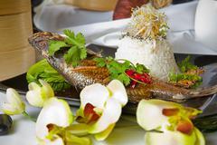 australian barramundi, served with fragrant jasmine.rice and wilted bok choy - stock photo