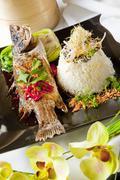 Australian barramundi, served with fragrant jasmine.rice and wilted bok choy Stock Photos