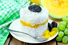 rice with pumpkin and grapes on the board - stock photo
