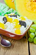 rice with pumpkin and prunes on the board - stock photo