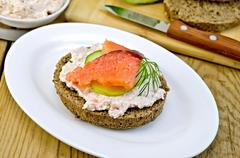 sandwich with cream and salmon on an oval plate - stock photo