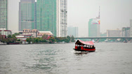 Stock Video Footage of bangkok - apr 10: tourist ferry boat crosses a river with people on apr 10, 2