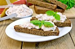 sandwiches with cream of salmon and mayonnaise on the board - stock photo