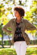 Autumn outdoor portrait of beautiful african american young woman - black peo Stock Photos