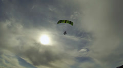 Aerial shot ultralight powered parachute flying into hazy sun HD 0186 Stock Footage