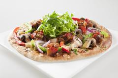 spicy gourmet eggplant and capsicum pizza - stock photo