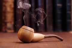 smoking tobacco pipe - stock photo
