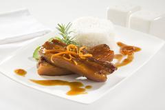 Orange and whiskey glazed pork.spare ribs. Stock Photos