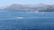 Stock Video Footage of Boat and Jet Ski of the Coast of Croatia