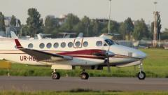 Charter jet with two propellers turning steering for take-off, click for HD - stock footage