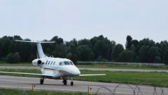 Small jet Hawker Beechcraft 390 Premier IA steering in airport, click for HD - stock footage