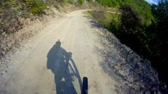 Mountain biker fast downhill sport race ride stock video Stock Footage
