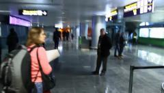 Airport walkthrough. People in the terminal hall (lobby)., click for HD Stock Footage