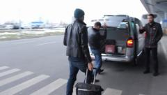 Airport to taxi walkthrough, people carrying bags. Airplane taxi, click for HD Stock Footage