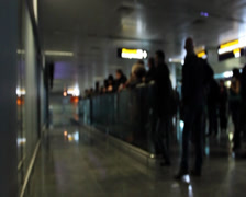 Arriving and waiting people in airport terminal meeting point, click for HD Stock Footage